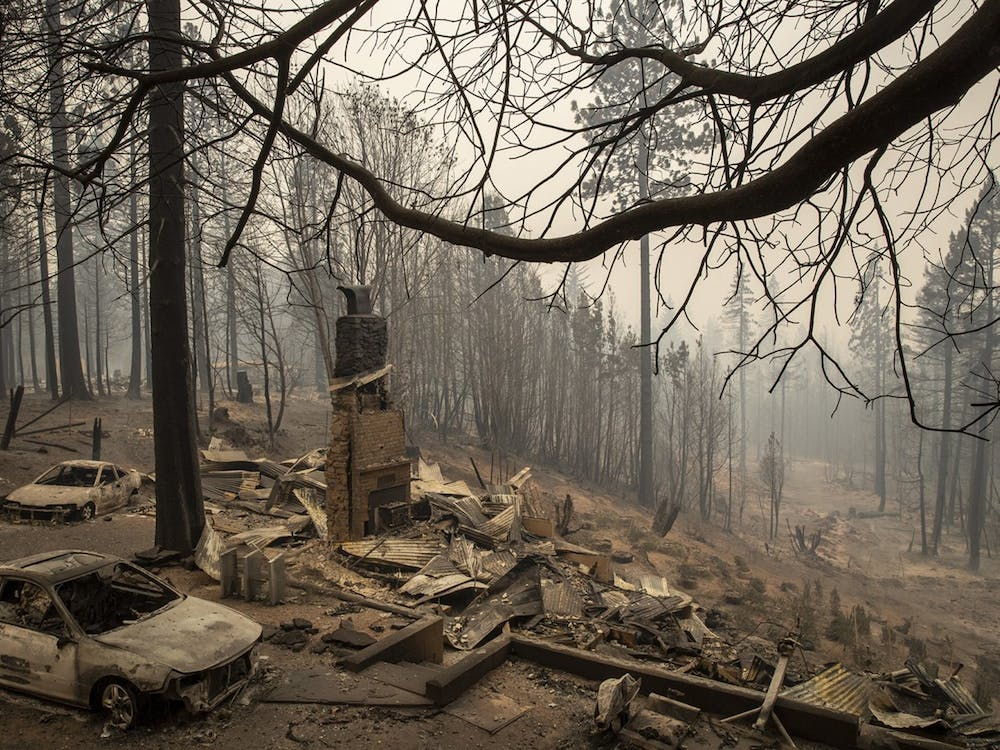 A home smolders in ruins in the aftermath of the Bear fire Thursday in Brush Creek, California.