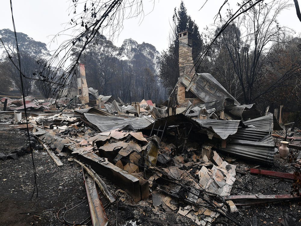 Remains of a woodchip mill burnt by bushfires is seen Jan. 6 as smoke rises in Quaama, New South Wales, Australia. The brush fires in Australia started in December 2019.