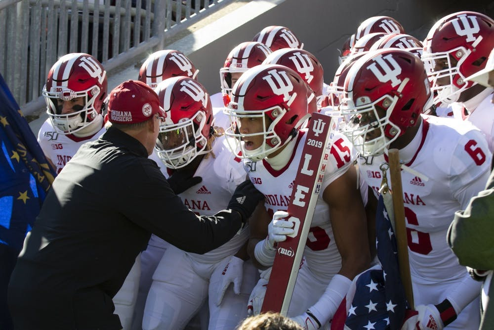 <p>IU football head coach Tom Allen pumps his players up before a game Nov. 16, 2019, at Beaver Stadium in State College, Pennsylvania. Indiana beat Western Kentucky University 33-31. </p>
