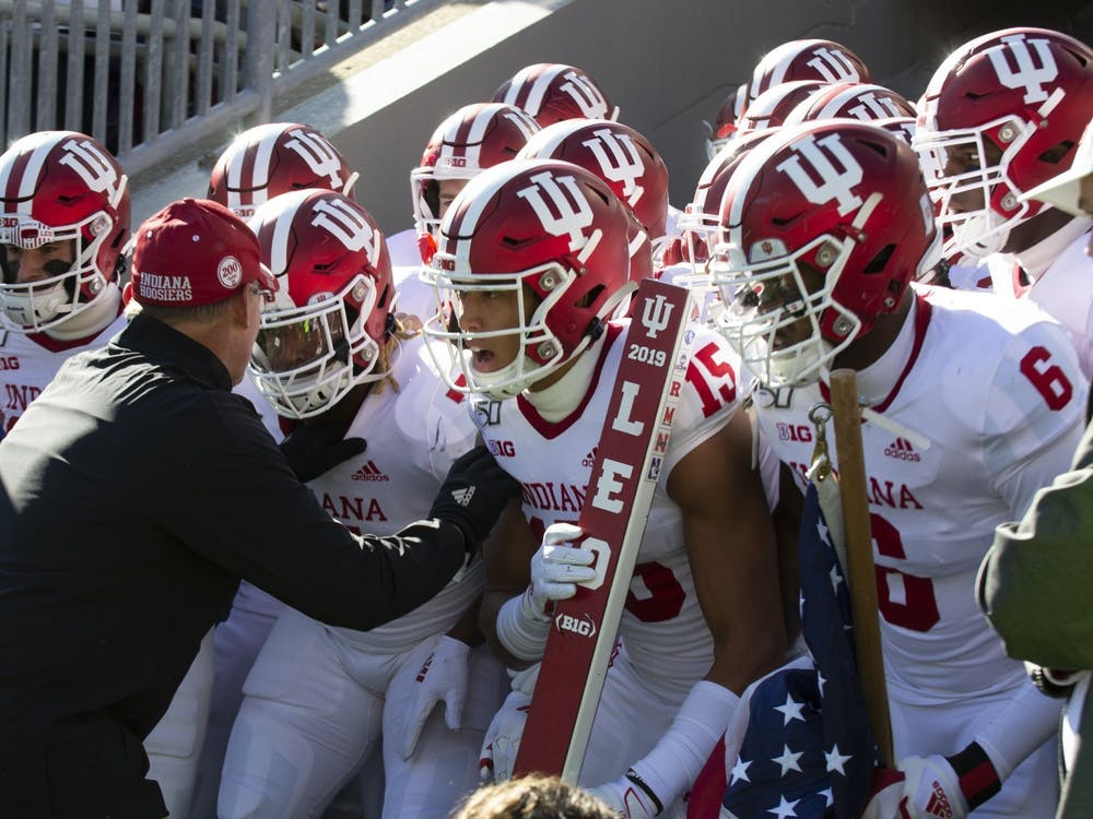 IU football head coach Tom Allen pumps his players up before a game Nov. 16, 2019, at Beaver Stadium in State College, Pennsylvania. Indiana beat Western Kentucky University 33-31.