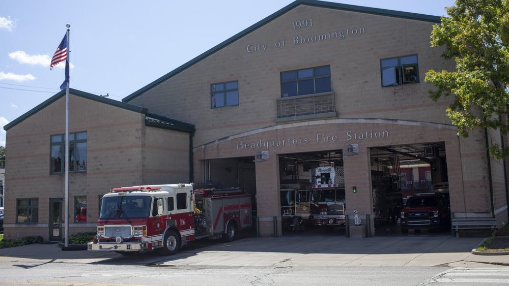 The City of Bloomington Fire Department sits with its doors open on August 28 on E 4th St. The Bloomington Fire Department and Bloomington Police Department both experienced flood damage to their respective headquarters after last weekend's storms, according to City of Bloomington press releases.