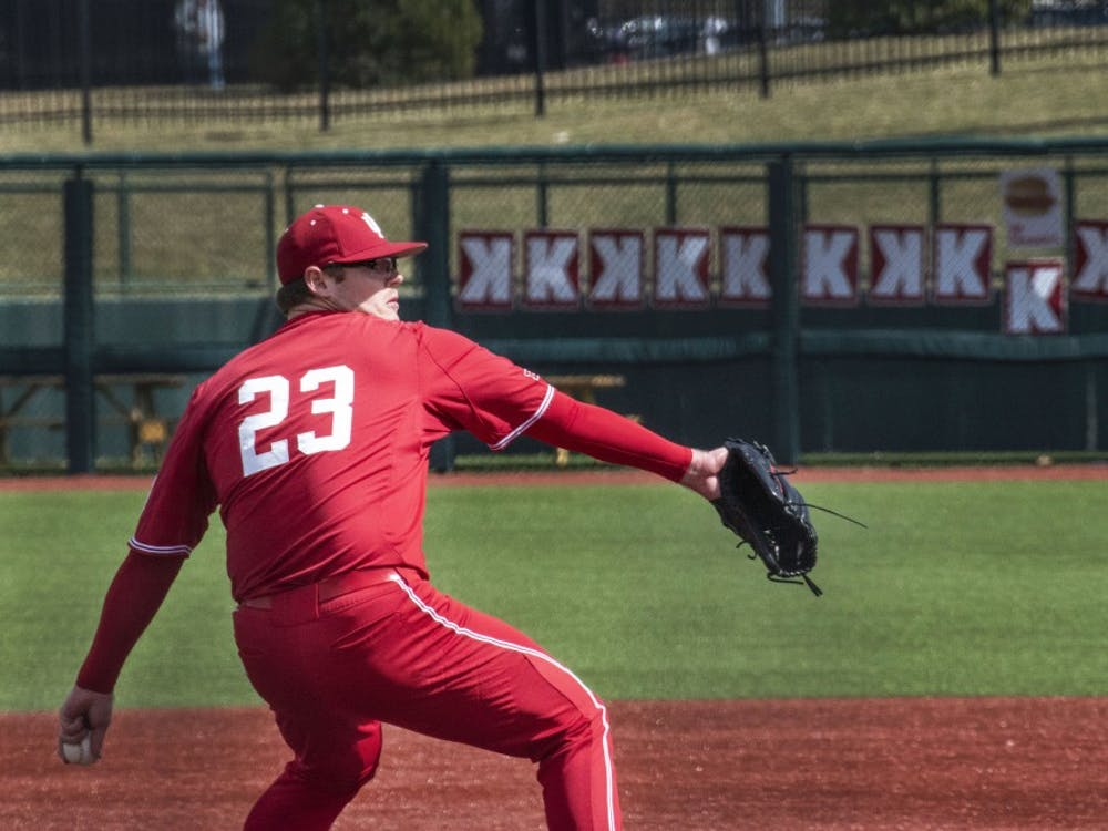 Junior pitcher Andrew Saalfrank pitches against Canisius College on March 17 at Bart Kaufman Field. Saalfrank recorded 14 strikeouts in Indiana's 12-1 win.
