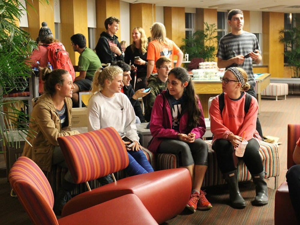 Students talk during an election watch party. Forest Honors Council, part of the Hutton Honors Council Association, provides patriotic cookies and cupcakes to anyone that attended the election night viewing party in the Forest Quad building's Treehouse on Tuesday night.