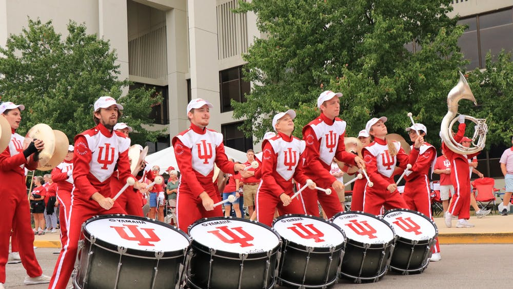 IU Marching Hundred bass drummers play pregame music before a football game against University of Connecticut on Sept. 21 near Simon Skjodt Assembly Hall. The Marching Hundred performs at every IU home football game.