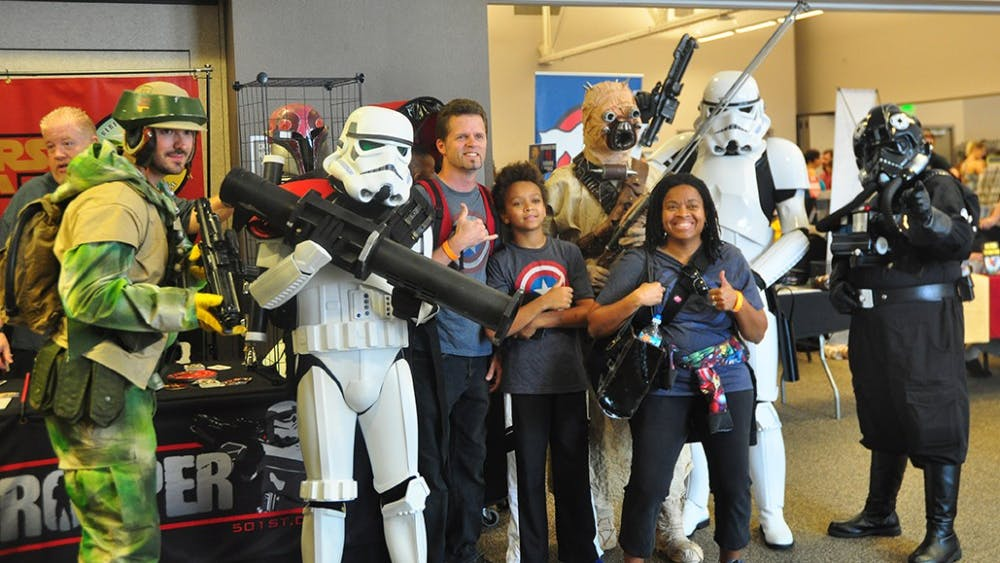 Visitors take photos with cosplayers potraying  Star Wars characters at the Indiana Toy and Comic Expo that took place at the Monroe County Covention Center Sunday afternoon.