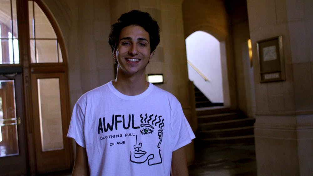 Charles Zayed, sophomore and co-owner of Awful Cloth, poses in a T-shirt designed by his clothing line. Zayed and Fordham University student Emmit Flynn have had about 1,000 sales since their clothing line company went online in August.