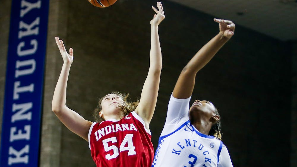 Sophomore Mackenzie Holmes fights for a rebound Dec. 6 against the University of Kentucky in Lexington, Kentucky. IU lost 68-72.