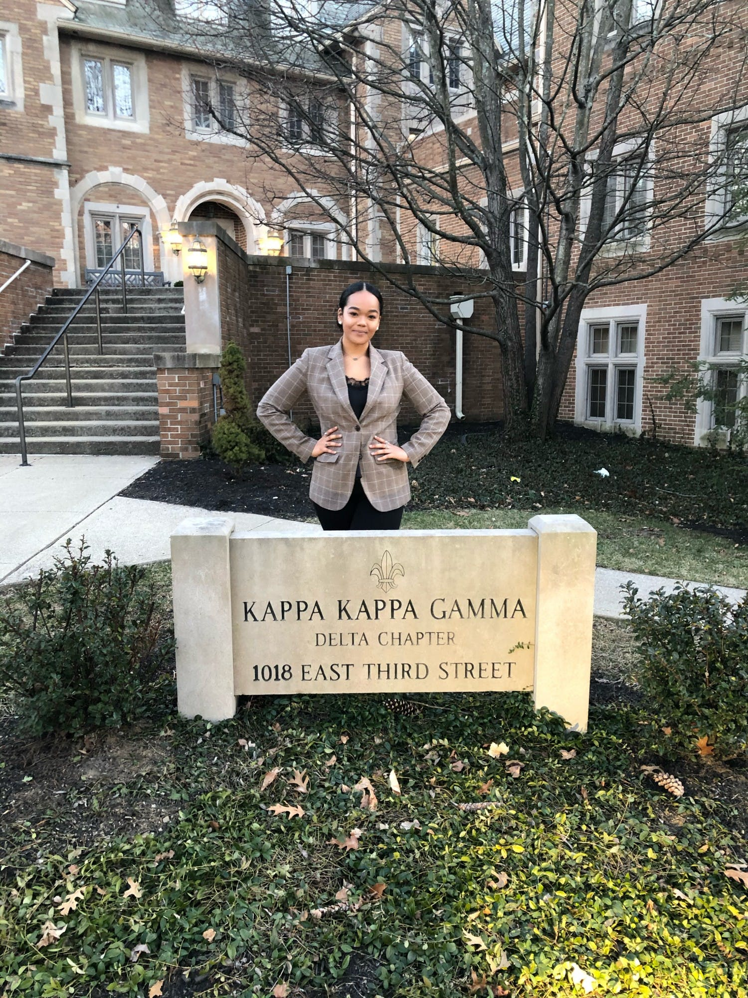 Langdan Willoughby stands in front of the Kappa Kappa Gamma house at 1018 E. Third St. in February 2020. IU's Delta chapter is the sorority's oldest continuously active chapter.