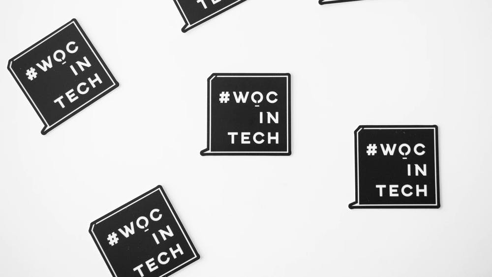 "A graphic displays the message ""#WOCinTech,"" supportive of women of color in tech industries."