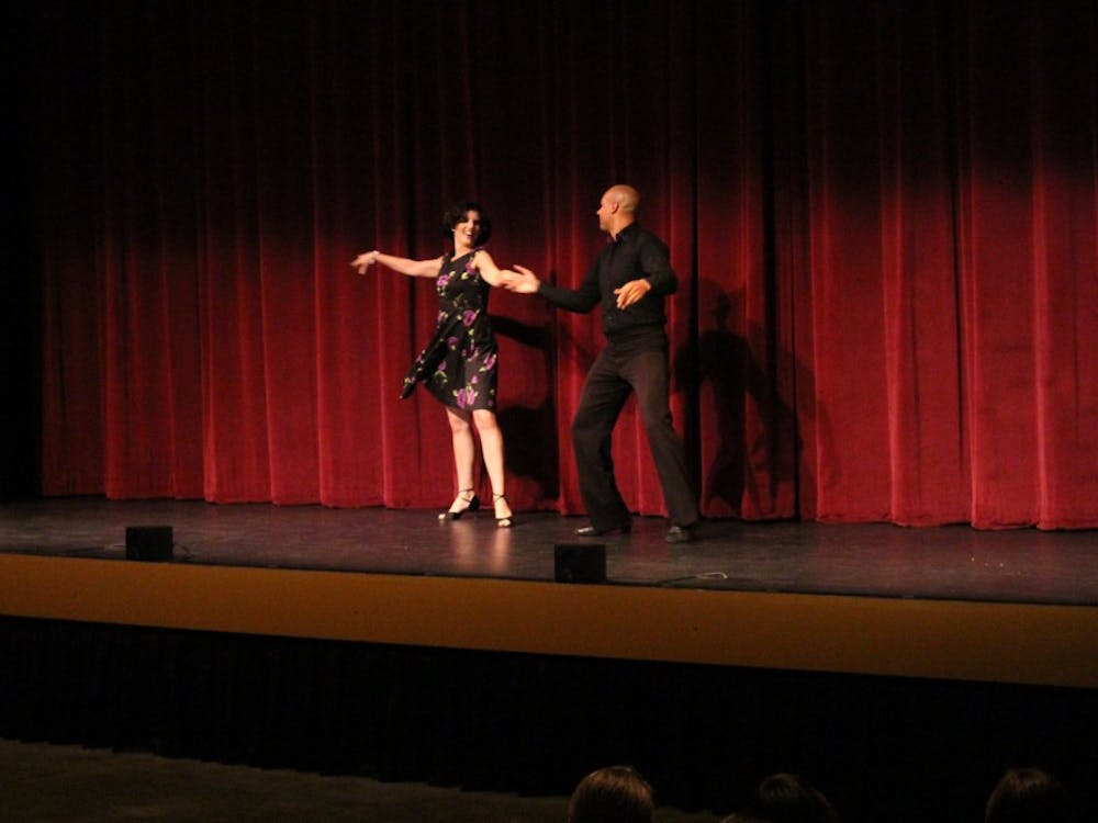 """Dancers from Arthur Murray Dance Studio perform a demo for audience members Friday night at the Buskirk-Chumley Theater. The performance was part of the Buskirk-Chumley Theater's """"Dance Moves and Movies"""" series."""