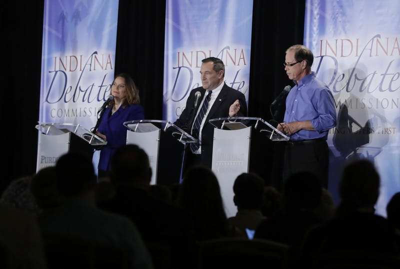 Libertarian Lucy Brenton, Democratic Sen. Joe Donnelly and Republican former state Rep. Mike Braun, from left, participate in a U.S. Senate Debate on Oct. 8 in Westville, Ind.