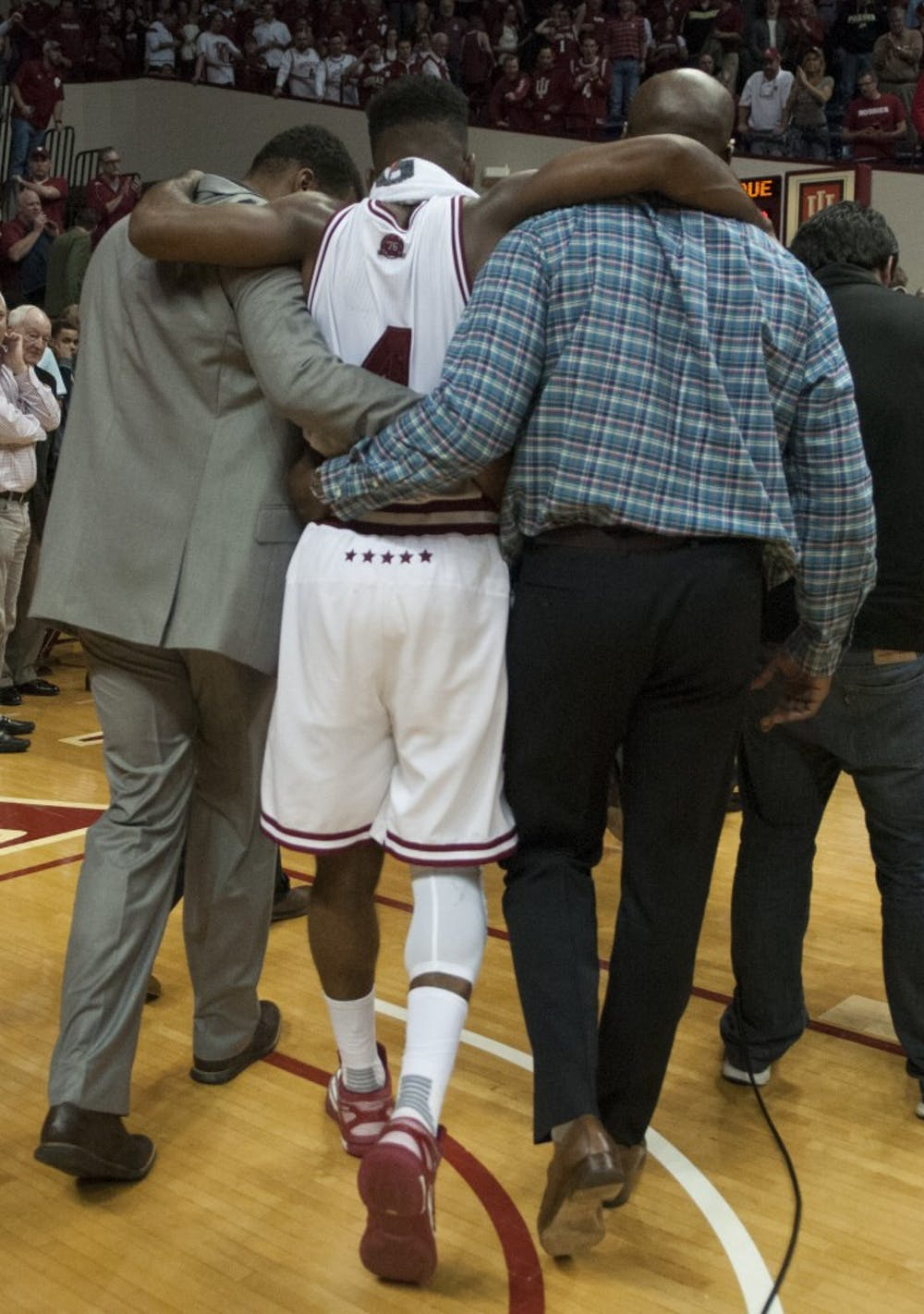 Sophomore guard Robert Johnson is helped off the court after the game against Purdue on Saturday at Assembly Hall. The Hoosiers won 77-73.