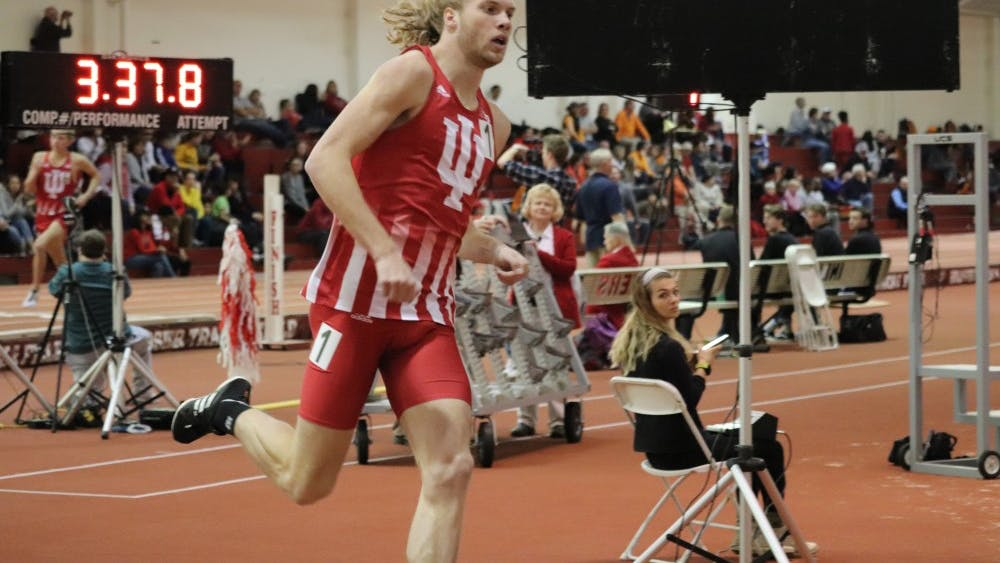 Distance runner Cooper Williams leads in the one-mile race Jan. 5 in Gladstein Fieldhouse. Williams finished in first place against University of Tennessee.