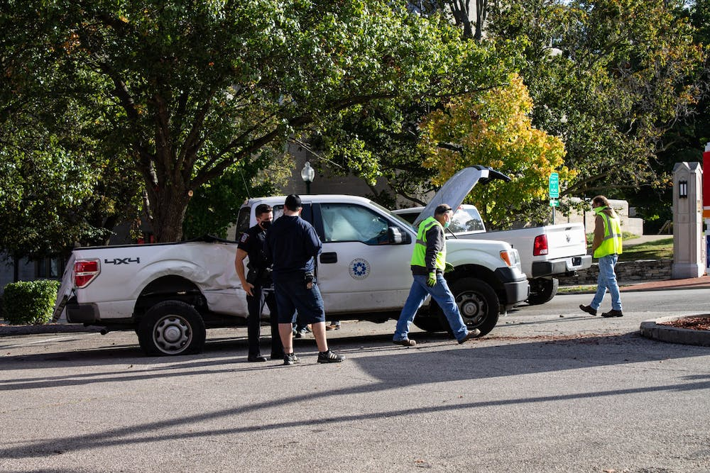 <p>IU Police Department officers and attend to an accident Tuesday at the Circle K at the corner of Third Street and Indiana Avenue.</p>