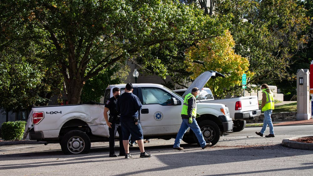 IU Police Department officers and attend to an accident Tuesday at the Circle K at the corner of Third Street and Indiana Avenue.
