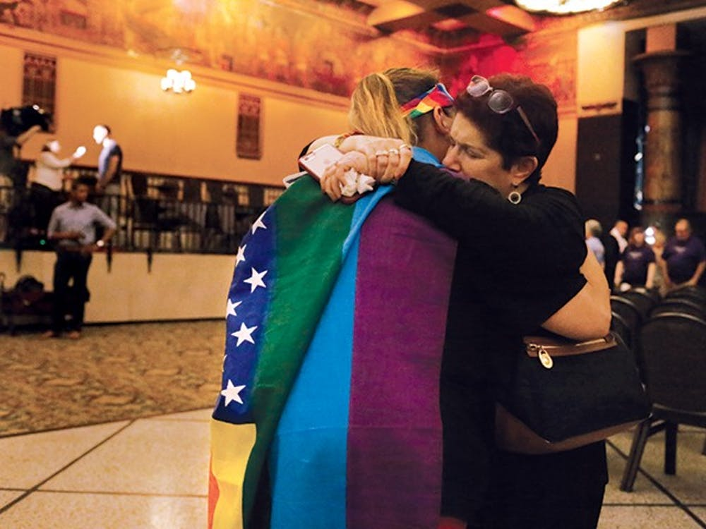 """Kim Saylor, left, hugs Annette Gross, right, after the end of a vigil, which took place in the Egyptian Room at the Old National Centre Sunday evening and was sponsored by Indy Pride in response to the recent mass shooting that took place at a gay night club in Orlando, Florida. """"I wouldn't have been anywhere but here today,"""" Saylor said. """"The hate has got to end."""""""