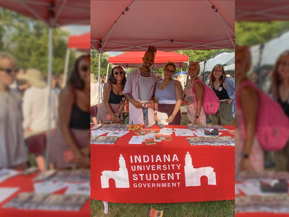 Members of Indiana University Student Government pose for a photo at their booth Aug. 26, 2021, at the Student Involvement Fair in Dunn Meadow.