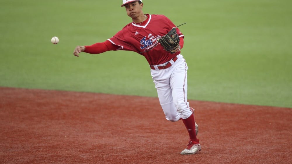 Then-freshman Justin Walker throws the ball to first base during the Hoosiers' game against the Indiana State Sycamores on April 10.
