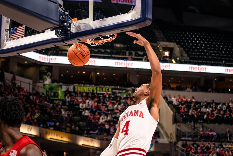Then-freshman forward Trayce Jackson-Davis dunks the ball on Nebraska on March 11 at Bankers Life Fieldhouse in Indianapolis. IU announced a partnership with the Opendorse Ready program Wednesday to help student-athletes with potential changes to the NCAA's policies on financial compensation for name, image and likeness.