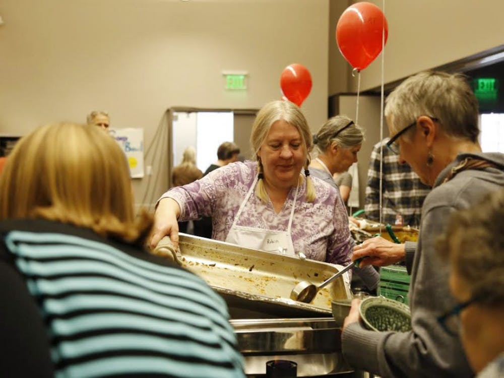 Robin Menzyka, a volunteer at the 24th Annual Soup Bowl Benefit, serves soup for attendees Sunday, Feb. 18. The soup bowl is a fundraising opportunity for Hoosier Hills Food Bank that served soup from 42 local business this year.