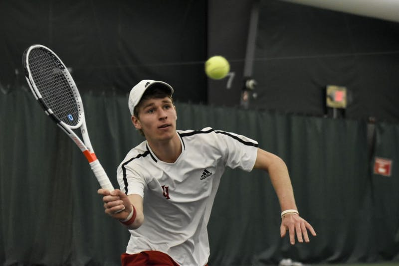 Then-sophomore Bennett Crane reaches for a forehand during his 6-2, 6-7, 4-6 singles loss against Wisconsin last season at the IU Tennis Center.