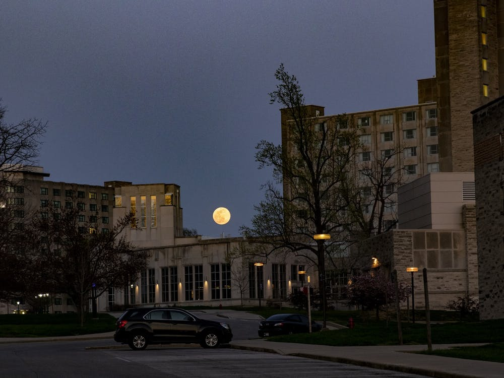 The supermoon shines April 7 above Forest Residence Hall.