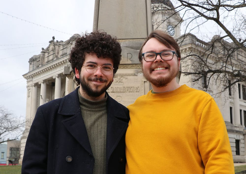 <p>Indiana Daily Student city beat reporters Ty Vinson and Joey Bowling pose for a photo Feb. 27 in front of the Monroe County Courthouse. The Indiana Daily Student created two city beat reporter positions with funding from the Media School.</p>