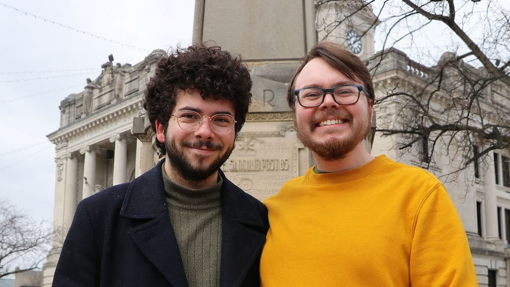 Indiana Daily Student city beat reporters Ty Vinson and Joey Bowling pose for a photo Feb. 27 in front of the Monroe County Courthouse. The Indiana Daily Student created two city beat reporter positions with funding from the Media School.