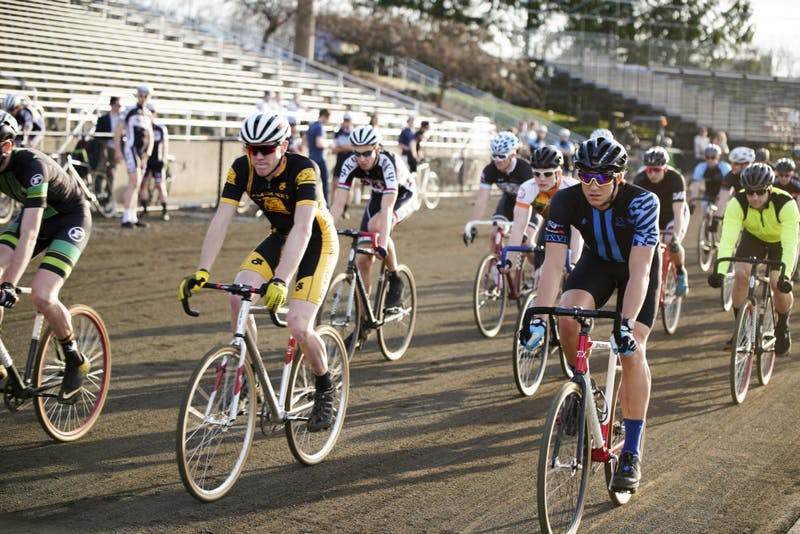 Participants race around the track to complete 50 laps during a practice session for Little 500 on Thursday evening at Bill Armstrong Stadium.