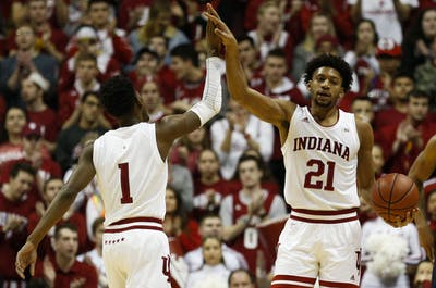 Junior guard Aljami Durham high-fives redshirt-freshman forward Jerome Hunter after scoring a basket. IU lead Penn State 37-24 at halftime Feb. 23 in Simon Skjodt Assembly Hall.