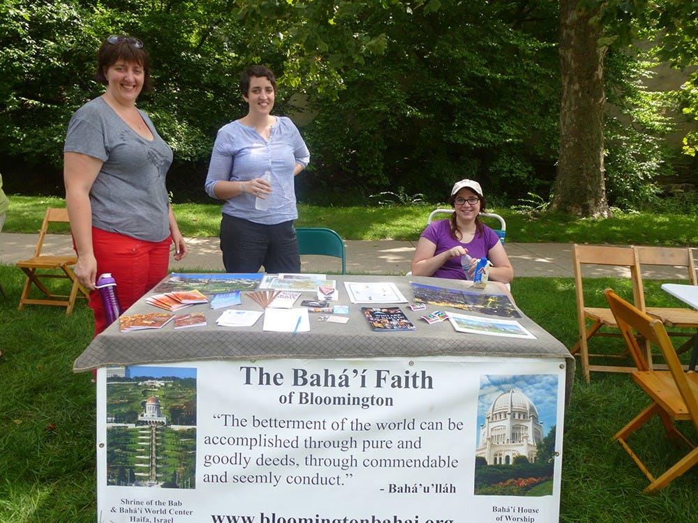 Bahá'í Faith members Sarah Enslow, Ruth Enslow and IU Alum Natalie Bantz represent the Bahá'í Faith of Bloomington center at Faith Fest. The Bahá'í Faith of Bloomington center offers weekly devotion to community members every Sunday at 10:30am.