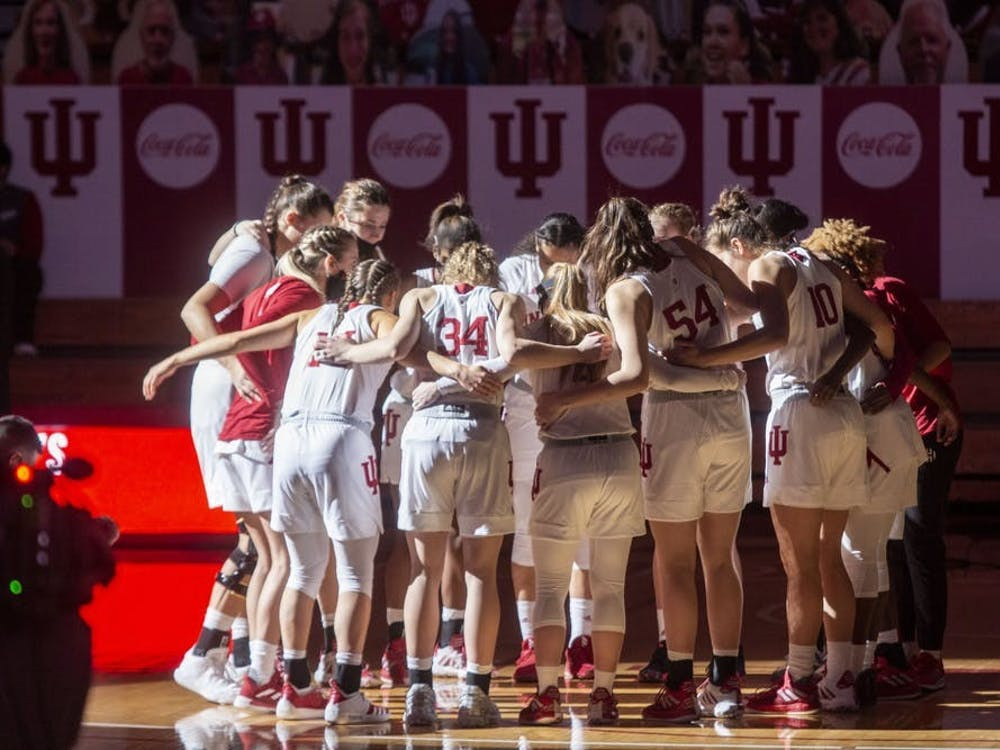 The IU women's basketball team huddles before its game against Wisconsin on Jan. 10 in Simon Skjodt Assembly Hall. The Hoosiers defeated the Illinois Fighting Illini 58-50 on Sunday.