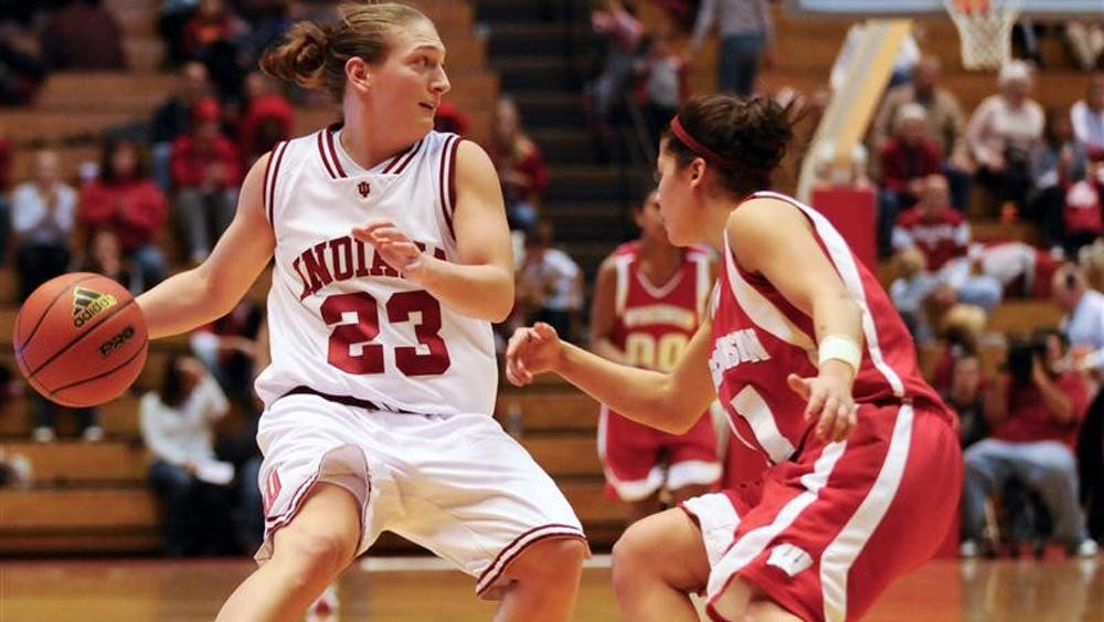 IU guard Jamie Braun looks to pass during IU's 64-61 win over Wisconsin  Jan. 15 at Assembly Hall. Braun had 14 points.