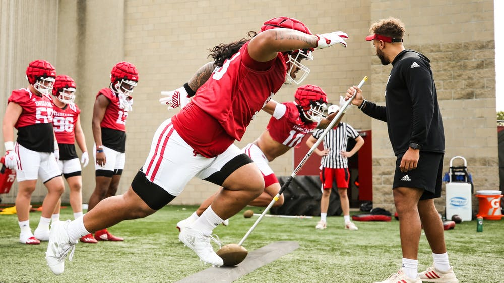 Junior defensive lineman Sio Nofoagatoto'a participating in a drill during IU football's fall camp Aug. 6 in Bloomington. Nofoagatoto'a said the team's first game against Iowa will serve as a test for the defensive line during a press conference Aug. 11.