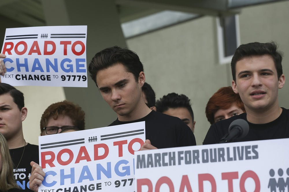 <p>Parkland shooting survivors David Hogg and Cameron Kaskey (left to right) hold signs during a press conference June 4, 2018, for the March for Our Lives movement in Parkland, Florida. </p>