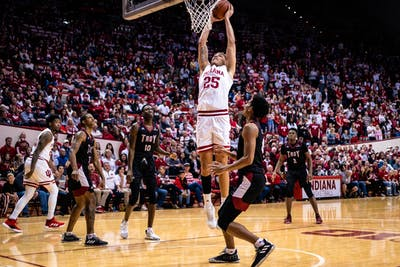 Redshirt sophomore Race Thompson dunks the ball against Troy University on Nov. 16 at Simon Skjodt Assembly Hall. IU is favored to win against Princeton University tonight in Assembly Hall.
