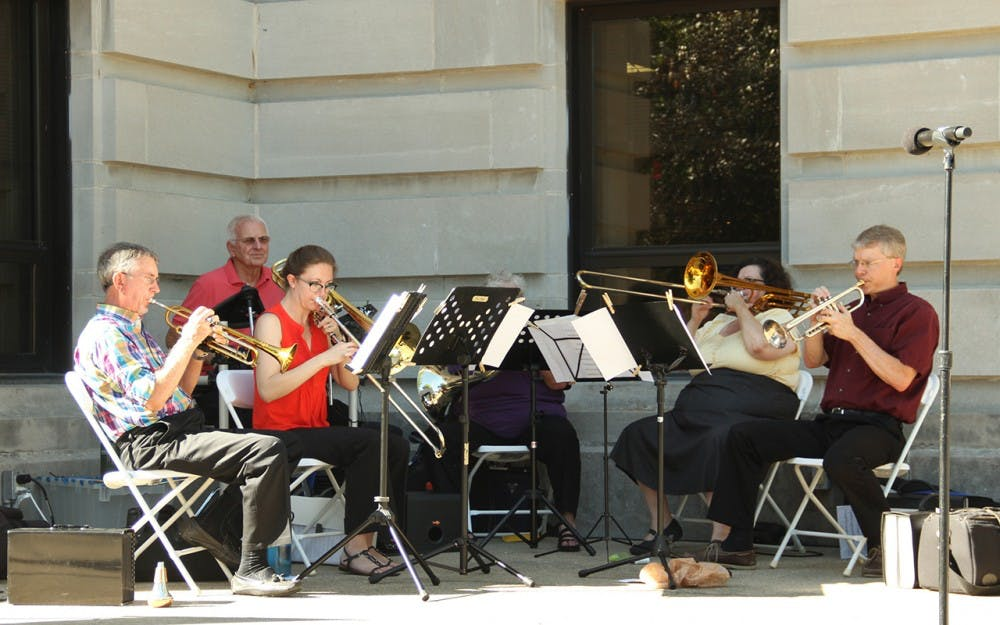 The Bloomington Brass Quintet performs during the Bicentennial Torch Relay Exhibit Tuesday at the Monroe County Courthouse lawn.