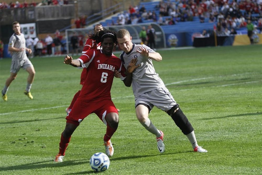 <p>Freshman forward Femi Hollinger-Janzen attempts to dribble past a Georgetown player Dec. 9 during the finals of the NCAA Division I men's soccer championship at Regions Park in Hoover, Alabama. IU won 1-0,.</p>