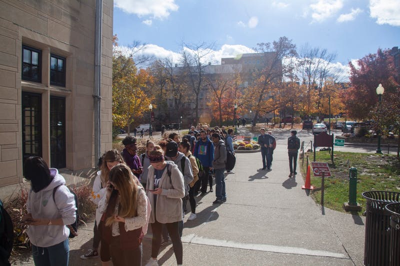 Students line up to vote outside the Indiana Memorial Union on Nov. 6, 2018.