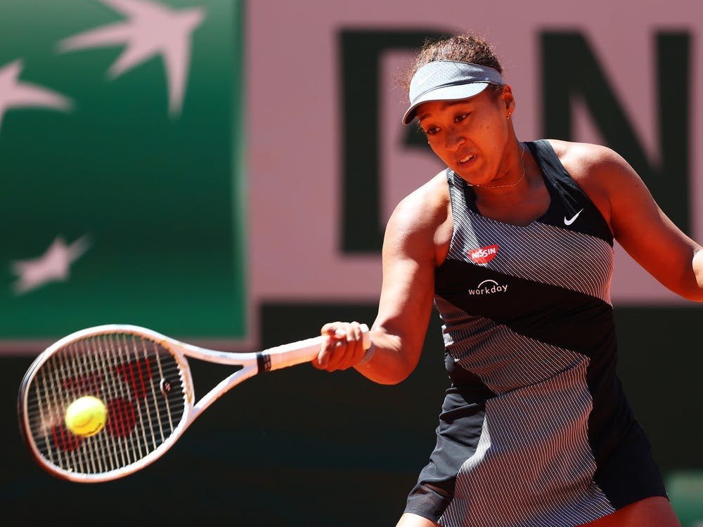 Naomi Osaka of Japan plays a forehand in her First Round match against Patricia Maria Tig of Romania during Day One of the 2021 French Open at Roland Garros on May 30, 2021 in Paris, France. Osaka withdrew from the French Open on May 31.