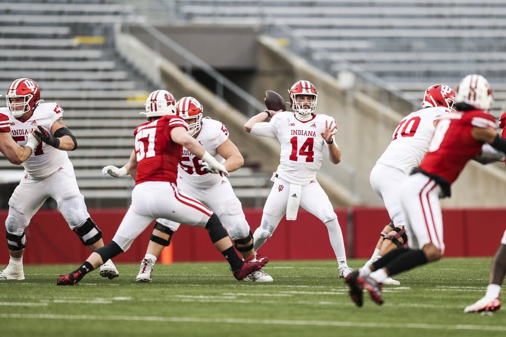 <p>Then-sophomore quarterback Jack Tuttle passes the ball Dec. 5, 2020, at Camp Randall Stadium in Madison, Wisconsin. Indiana football&#x27;s offense could look much different with Tuttle starting in place of junior Michael Penix Jr., who is &quot;week to week&quot; with an injury to his throwing shoulder. </p>