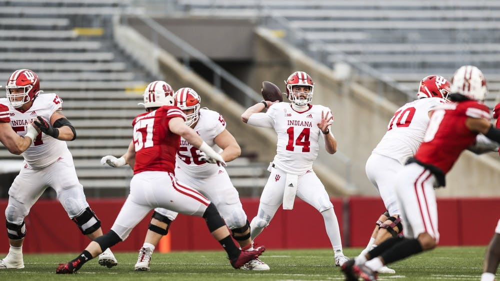 """Then-sophomore quarterback Jack Tuttle passes the ball Dec. 5, 2020, at Camp Randall Stadium in Madison, Wisconsin. Indiana football's offense could look much different with Tuttle starting in place of junior Michael Penix Jr., who is """"week to week"""" with an injury to his throwing shoulder."""