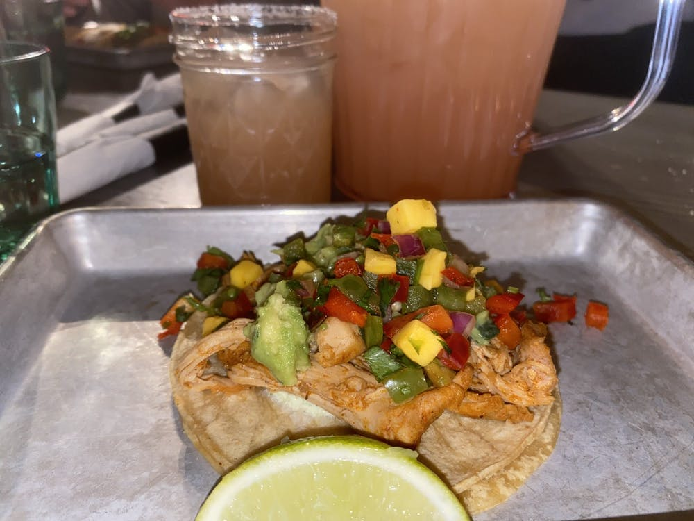 A chicken tinga taco from Social Cantina appears Wednesday. The taco is topped with tropical pico de gallo.