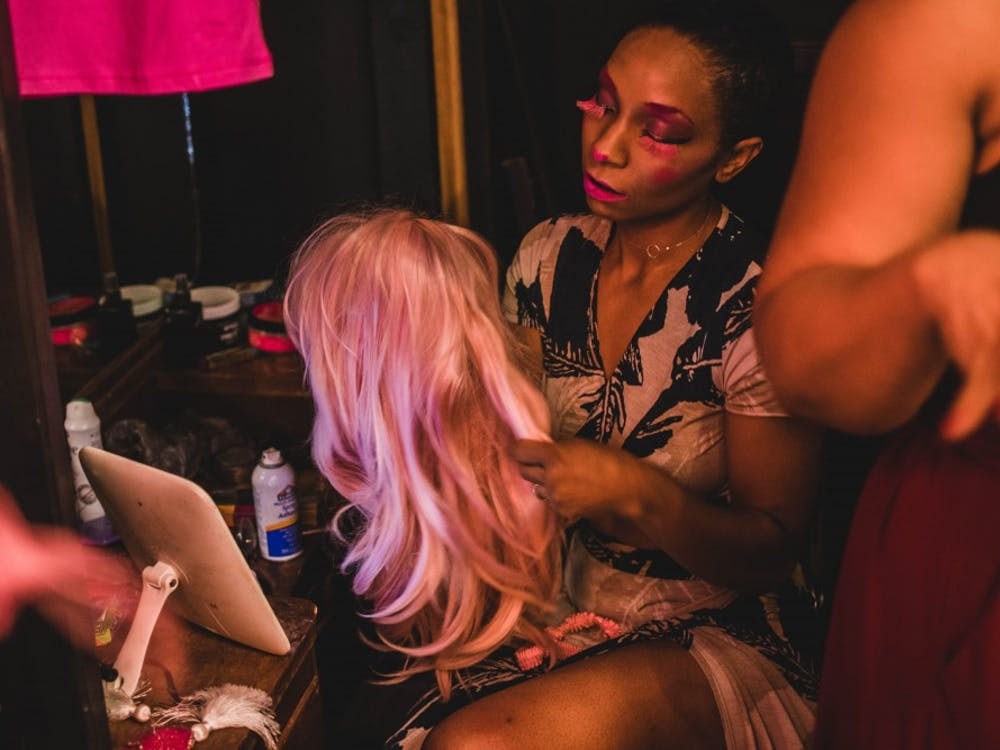 Burlesque performer Juju Bone prepares for her first routine backstage July 20 at the Back Door. In her daily life, Bone works in food service management.