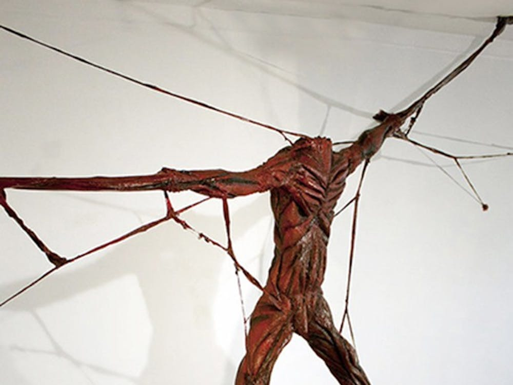 "MANIFESTED. An installation of flesh, nerve-endings represents torture and execution methods. The sculpture shows the idea of being trapped by the body. ""Conveying what it felt to have this constant wearing of pain and having to think about it all the time,"" Olney says. ""Trapped by it. It is now how I feel all the time, but sometimes it comes up."""