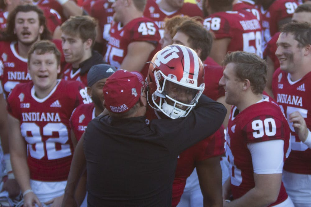 <p>Coach Tom Allen hugs quarterback Michael Penix Jr. after the No. 13 Hoosiers defeated the No. 23 Michigan Wolverines on Saturday at Memorial Stadium. The victory against Michigan was the first since 1987 for IU.</p>