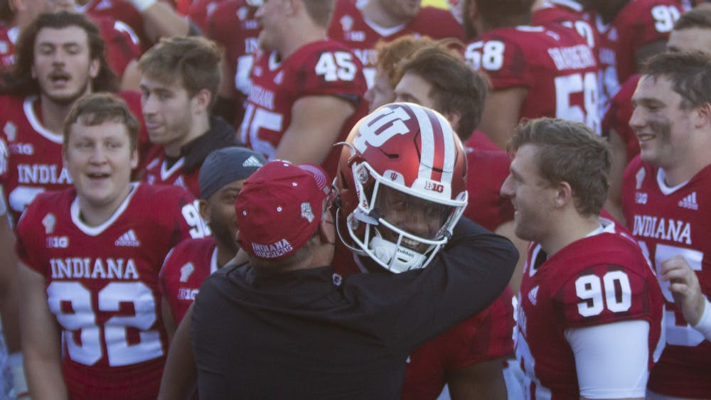 Coach Tom Allen hugs quarterback Michael Penix Jr. after the No. 13 Hoosiers defeated the No. 23 Michigan Wolverines on Saturday at Memorial Stadium. The victory against Michigan was the first since 1987 for IU.