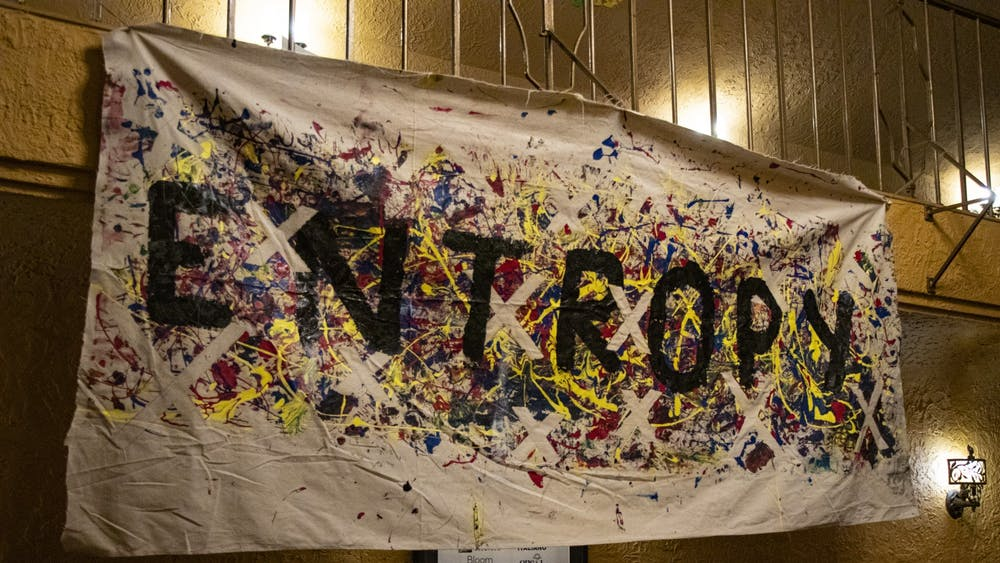 """A sign reading """"Entropy"""" for TEDxIU's theme hangs near the auditorium entrance Nov. 8 at the Buskirk-Chumley Theater. TEDx IU President Laxmi Palde said the sign was colored by IU students at a First Thursdays event earlier this semester."""
