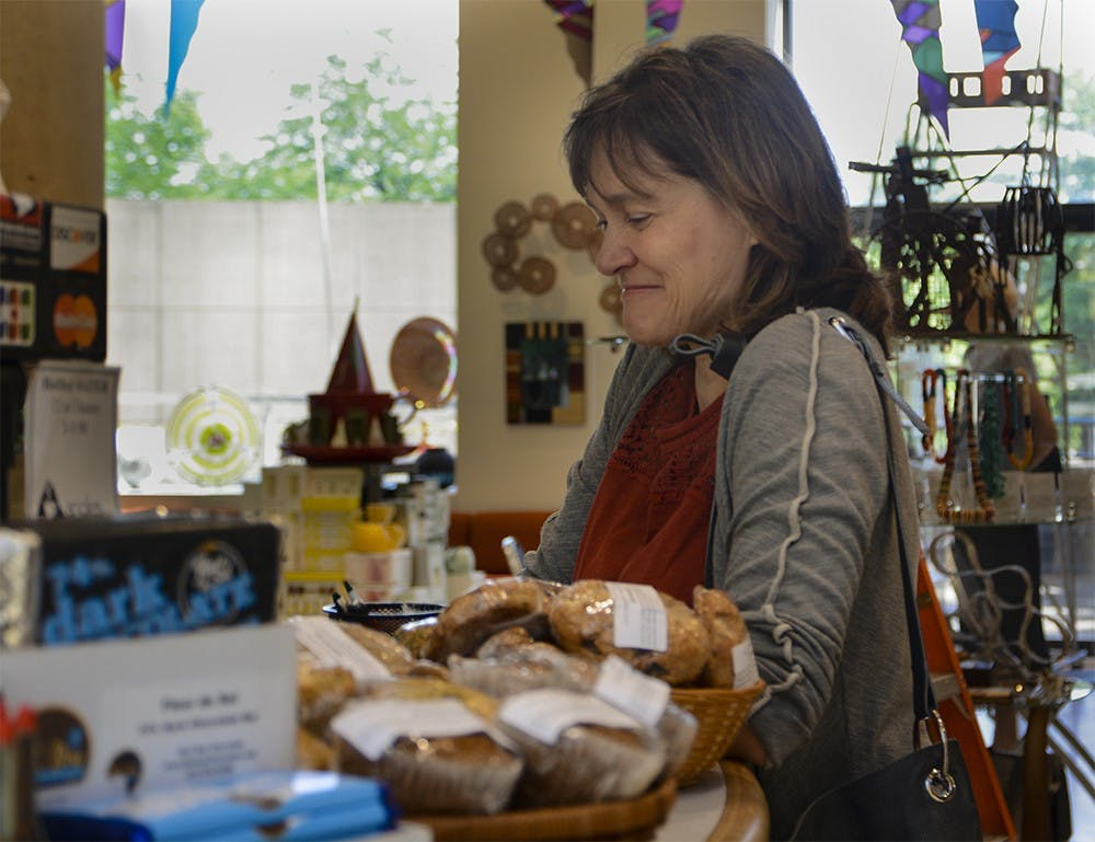 Marthe MacLeish, director of undergraduate studies of studio art department, orders coffee Friday Morning at the Eskenazi Museum of Art, Angles Cafe Gift Shop. MacLeish said she love to meet faculties and have holiday shopping in Angles.
