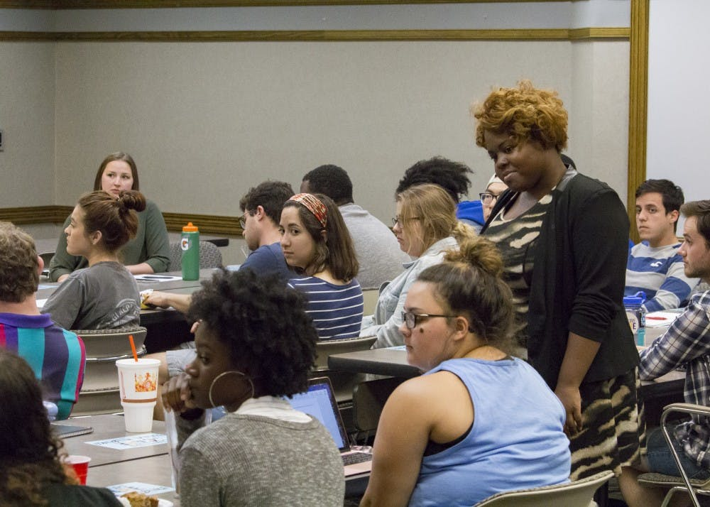 <p>Jazmin Jones, graduate assistant for Bystander Intervention, listens to audience responses at the #MeToo summit Thursday, April 12, in the Indiana Memorial Union. The event was organized by Culture of Care and opened with a discussion on sexual assault, prevention and policy on IU's campus.&nbsp;</p>